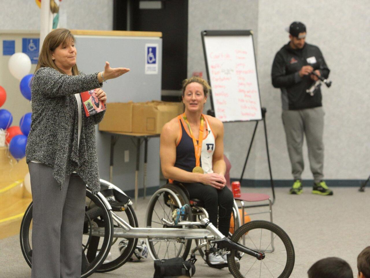 Del Mar Hills Academy Principal Julie Lerner tells her students how she taught Tatyana McFadden to swim when she was a young girl and announces the whole school will be reading Tatyana's book.
