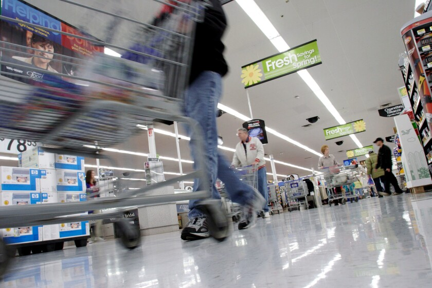 Shoppers look for merchandise at a Wal-Mart store in Bentonville, Arkansas.