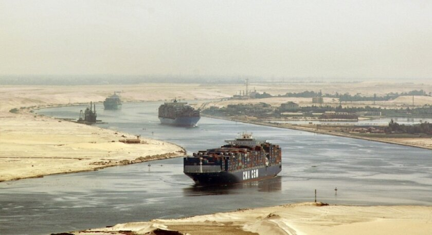 Concerns have been raised that a growing Islamist insurgency in Egypt's Sinai Peninsula could disrupt operations in the Suez Canal. Above, cargo ships sail through the Suez Canal near Ismailia, Egypt in 2009.