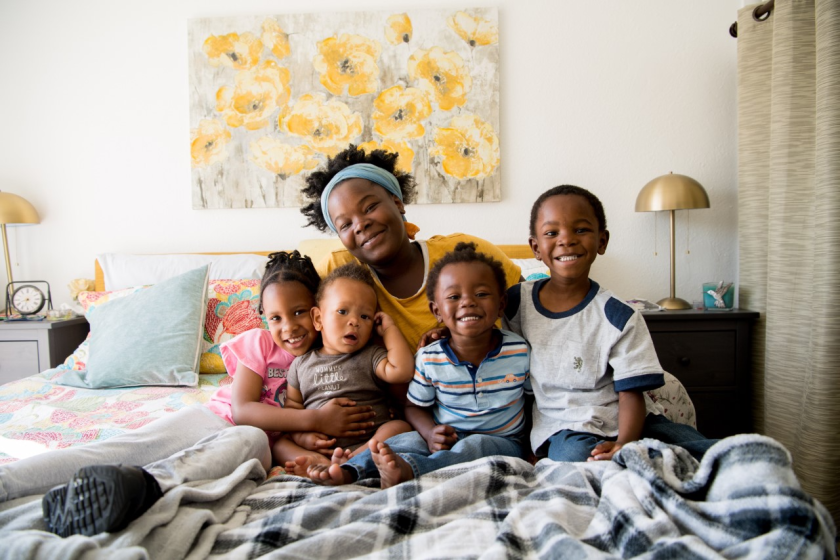 A Father Joe's Villages client and her children at their new apartment