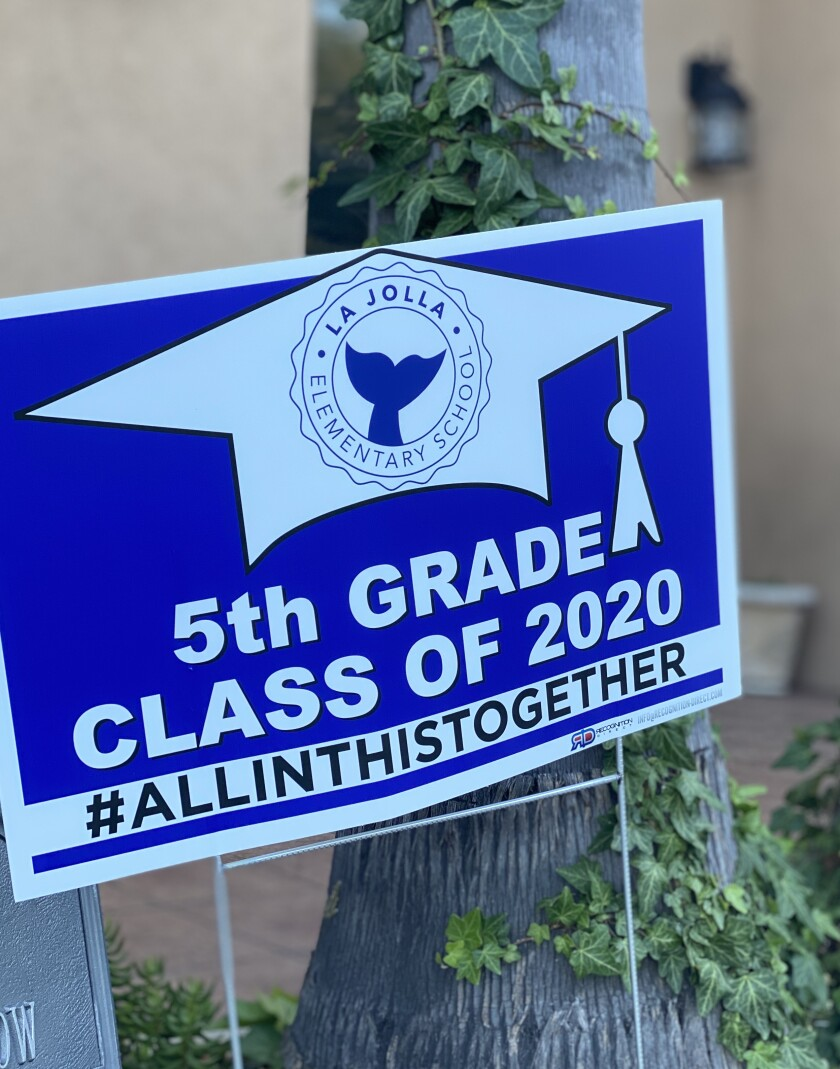 Fifth-graders at La Jolla Elementary received yard signs to soothe the sting of not having in-person promotion ceremonies.