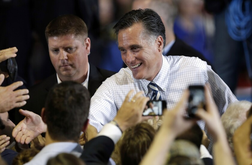 Republican presidential candidate and former Massachusetts Gov. Mitt Romney greets supporters during a campaign stop, Wednesday, Oct. 24, 2012, at the Eastern Iowa Airport in Cedar Rapids, Iowa.