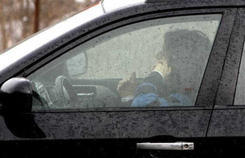 FILE - In this Feb. 10, 2010, file photo, a driver talks on a cell phone in Berlin, Vt. Distracted driving is more widespread in the U.S. than in Europe, according to a study released Thursday, March 14, 2013, that surveyed drivers about their cellphone and texting habits. More U.S. drivers reporte