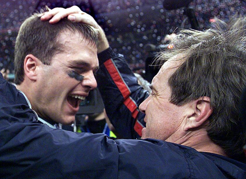 New England Patriots quarterback Tom Brady celebrates with coach Bill Belichick after defeating the St. Louis Rams in Super Bowl XXXVI on Feb. 3, 2002.