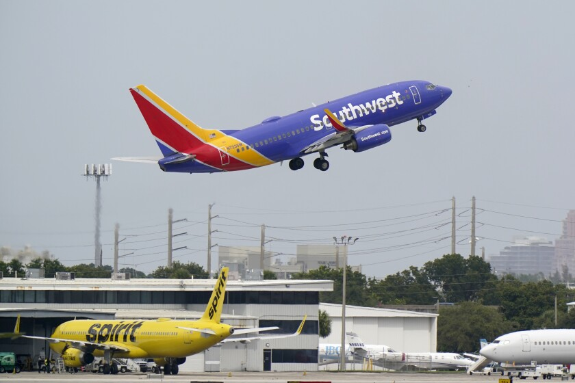 A Southwest Airlines Boeing 737-7H4 takes off, Tuesday, Oct. 20, 2020, from Fort Lauderdale-Hollywood International Airport in Fort Lauderdale, Fla. Airlines are continuing to pile up billions of dollars in losses as the pandemic causes a massive drop in air travel. Southwest Airlines on Thursday, Oct. 22, lost $1.16 billion in the normally strong third quarter, which includes most of the summer vacation season.(AP Photo/Wilfredo Lee)
