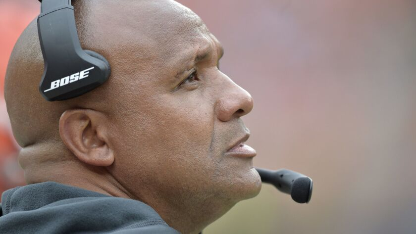 Cleveland Browns head coach Hue Jackson watches during the second half of an NFL football game again