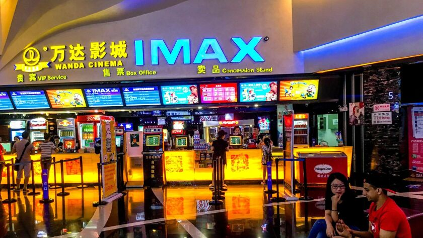 WEIFANG, SHANDONG PROVINCE, CHINA - 2016/08/30: Customers buy film ticket in a Wanda IMAX cinema. W