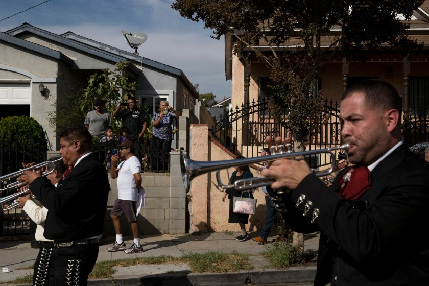 Mariachis march in Boyle Heights