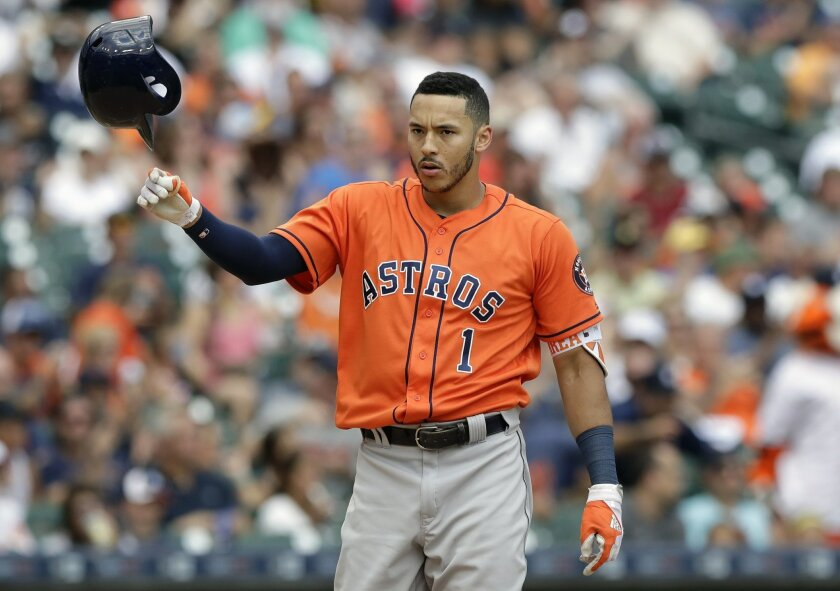 Houston Astros' Carlos Correa tosses his batting helmet after striking out to end the seventh inning with the bases loaded in a baseball game against the Detroit Tigers, Sunday, July 31, 2016, in Detroit. (AP Photo/Carlos Osorio)