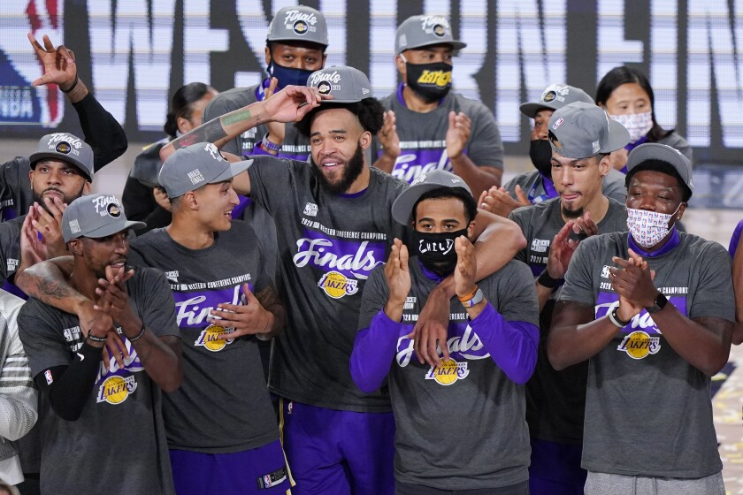 The Lakers celebrate after beating the Denver Nuggets in the Western Conference finals.