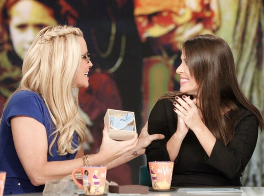 """Soleil Moon Frye announced on """"The View"""" that she's having a baby boy. The """"Punky Brewster"""" actress, right, gave a wrapped box to host Jenny McCarthy and said that the blue shoes inside revealed the baby's gender."""