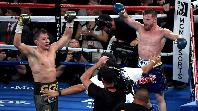 Gennady Golovkin and Canelo Alvarez both celebrate after the final round in their WBC, WBA and IBF middleweight championship bout at T-Mobile Arena on September 16, 2017 in Las Vegas.