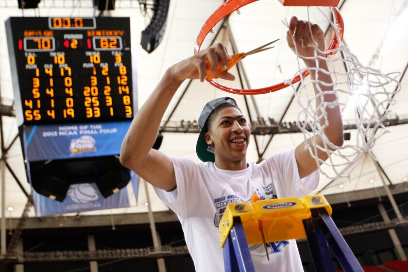 Anthony Davis cuts down the net after Kentucky efeated the Baylor 82-70 in the NCAA tournament championship game on March 25, 2012 in Atlanta.
