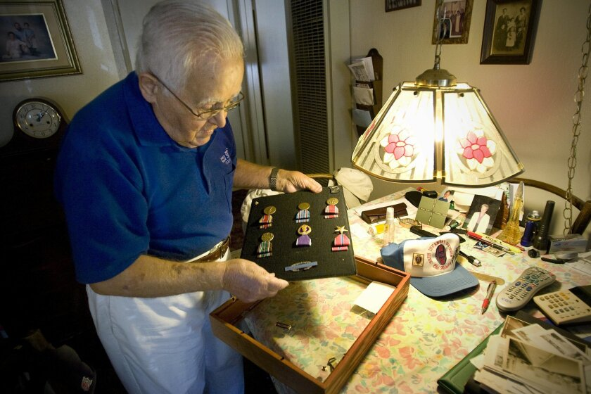 John D'Agostino, with his World War II medals, today heads for Maastricht, the Netherlands.