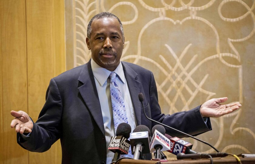 Republican presidential candidate Ben Carson takes questions from reporters Thursday at the Peninsula Hotel in Chicago.