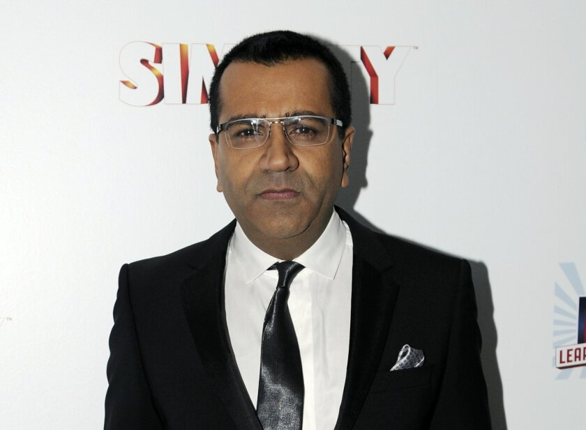 FILE - This Jan. 22, 2013 file photo shows Martin Bashir at the EA SimCity Learn. Build. Create. Inauguration After-Party, in Washington. The MSNBC host Bashir resigned from the network Wednesday, Dec. 4, 2013, nearly three weeks after making graphic remarks on the air about former Alaska Gov. Sarah Palin. (Photo by Nick Wass/Invision/AP, File)