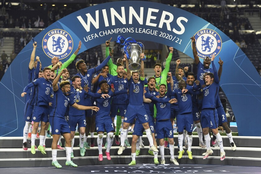 Chelsea's team captain Cesar Azpilicueta lifts the trophy at the end of the Champions League final soccer match between Manchester City and Chelsea at the Dragao Stadium in Porto, Portugal, Saturday, May 29, 2021. Chelsea won the match 1-0. (Pierre Philippe Marcou/Pool via AP)
