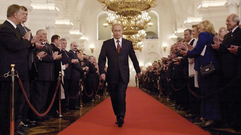 Russian President Vladimir Putin walks through St. George's Hall in the Kremlin to take part in his inauguration on May 7, 2004.