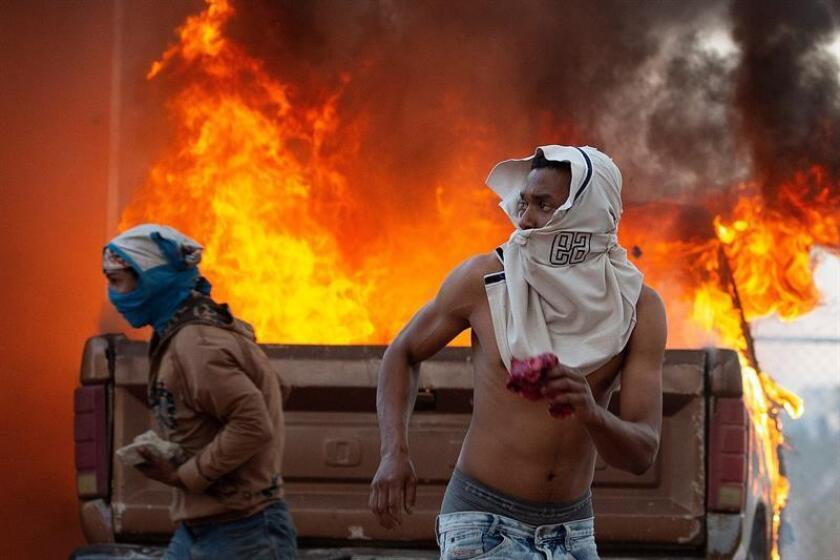 Anti-Chavistas clash with the Bolivarian National Guard of Venezuela this Feb. 23, 2019, on the border with Brazil, where four people were slain while more than 20 suffered bullet wounds, as the arrival of truckloads of humanitarian aid, forbidden to enter the country by the Maduro government, stirred up conflict there. EFE-EPA/Joedson Alves