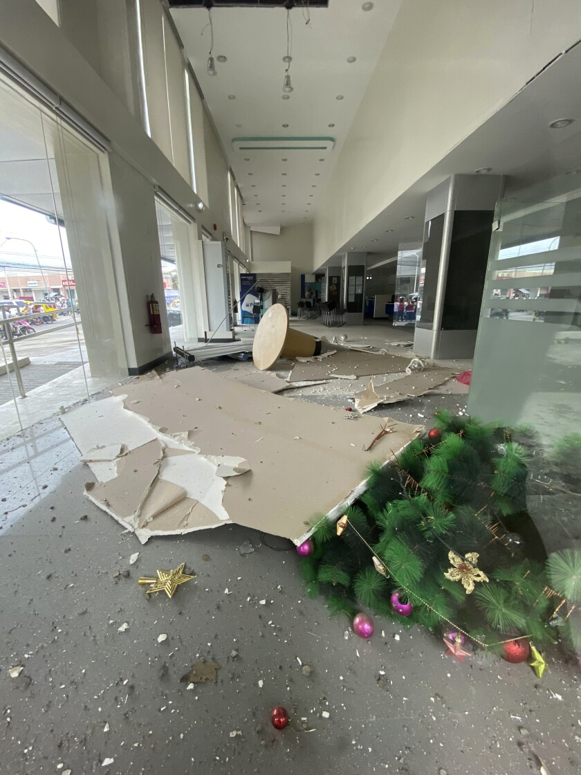 In this photo provided by the Philippine Red Cross, a Christmas tree and other debris lie on the ground inside a building after a strong earthquake shook Digos, Davao del Sur province, southern Philippines on Sunday Dec. 15, 2019. A magnitude 6.9 quake jolted the southern Philippines on Sunday, causing a three-story building to collapse and prompting people to rush out of shopping malls, houses and other buildings in panic, officials said. (Philippine Red Cross via AP)