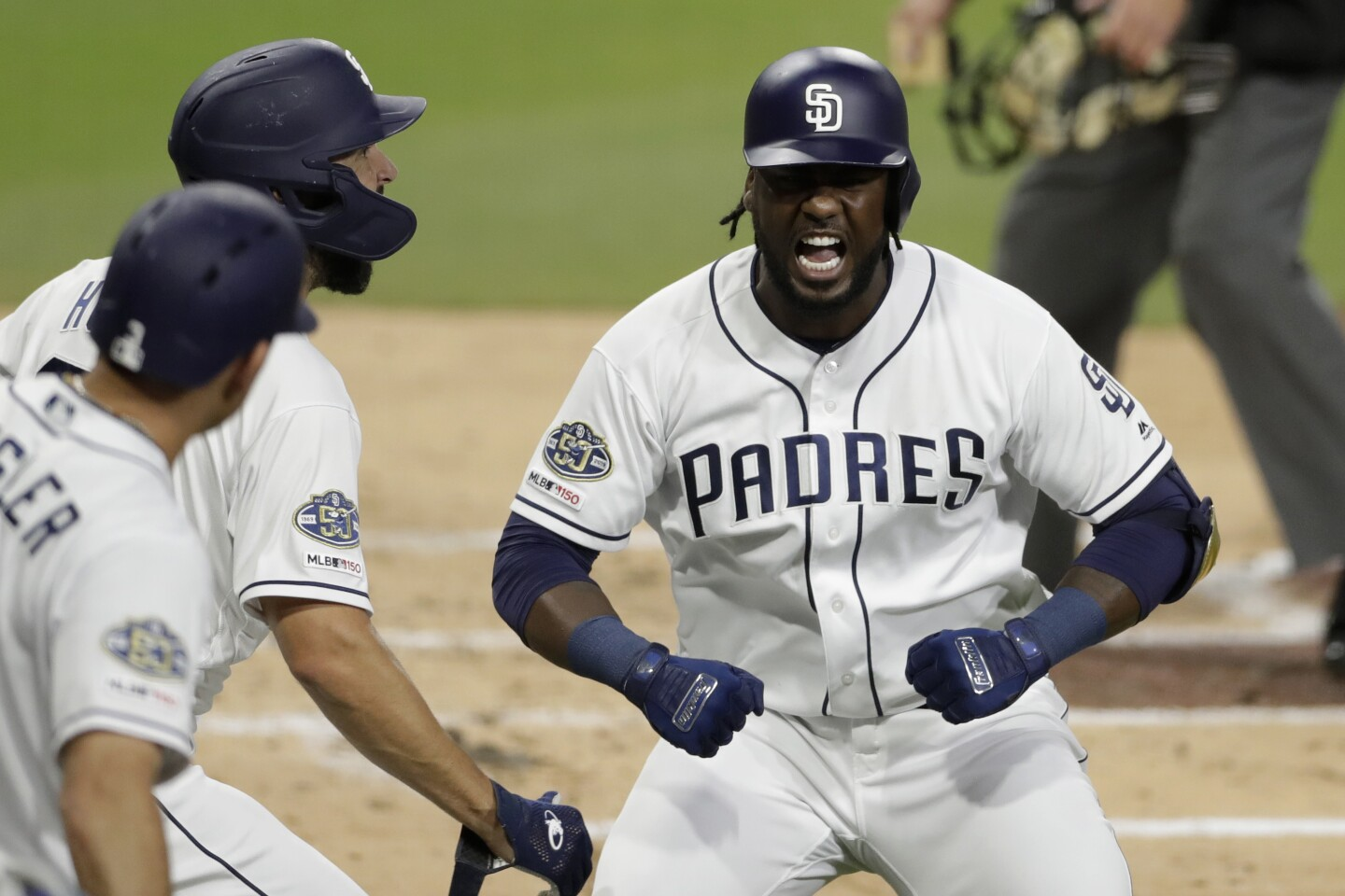 The Padres' Franmil Reyes, right, reacts with teammates after hitting a two-run home run during the second inning of a baseball game against the Seattle Mariners Tuesday, April 23, 2019, in San Diego.