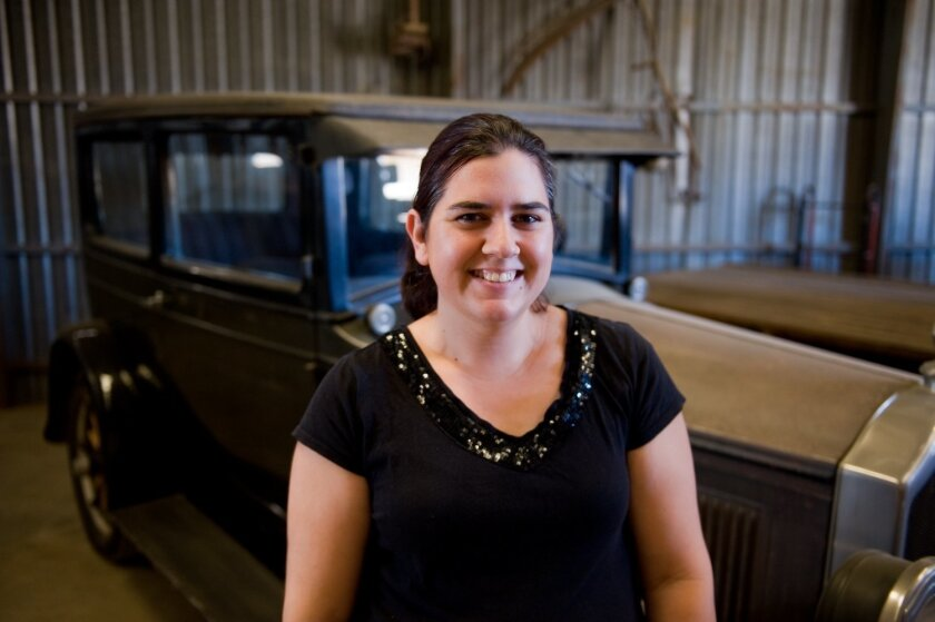 Ashley Jaques, curator of collections for the Antique Gas & Steam Engine Museum in Vista, stands in front of her family's 1926 Buick, which is kept with dozens of other antique automobiles at the museum off Santa Fe Road. CREDIT: Tom Pfingsten