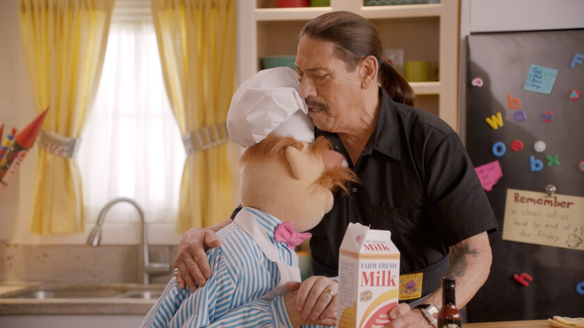 """The Swedish Chef and Danny Trejo share a tender moment on """"Muppets Now."""""""