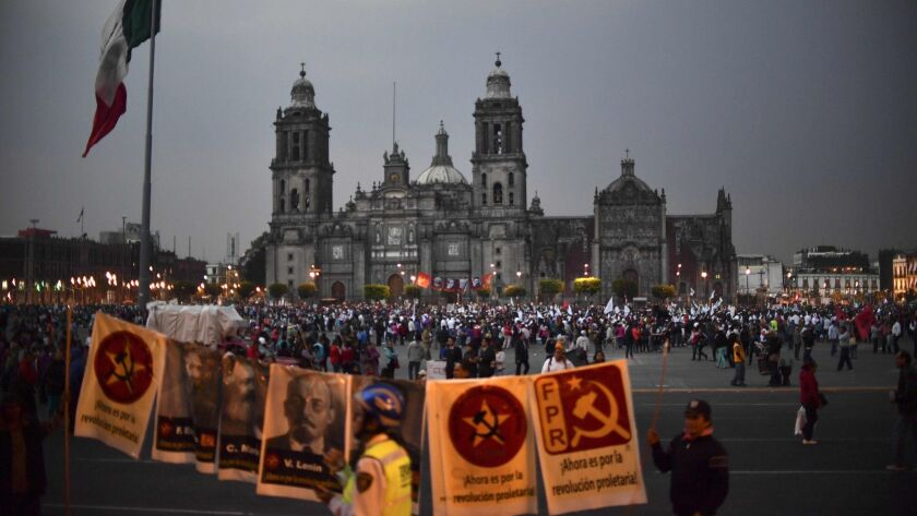 People gather Jan. 31 at El Zocalo square in Mexico City during a protest against a gasoline price increase and U.S. President Donald Trump's plan of building a wall on the border.