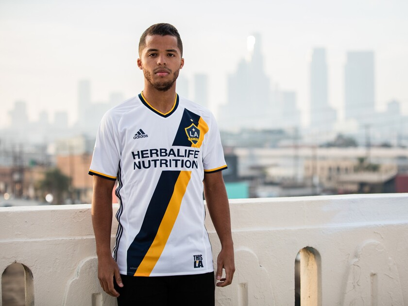 Galaxy forward Giovani dos Santos shows off the team's new look during a promotional shoot on Jan. 17.