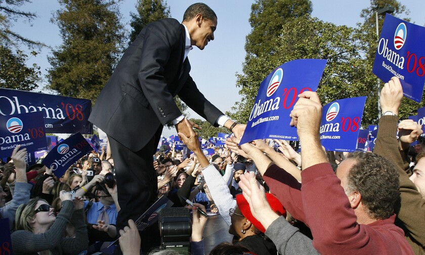 Then-presidential candidate Barack Obama greets supporters during a rally at Rancho Cienega Sports Complex on Rodeo Road in 2007.