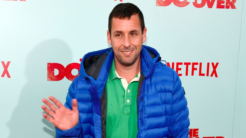 """Adam Sandler, a cast member in """"The Do-Over,"""" waves to photographers at the premiere of the film at the Regal LA Live theaters on May 16, 2016, in Los Angeles. (Chris Pizzello / Invision/Associated Press)"""