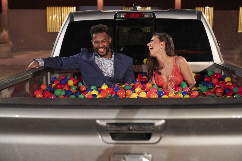 Suitor Tre and Bachelorette Katie Thurston in a truck bed filled with colored balls