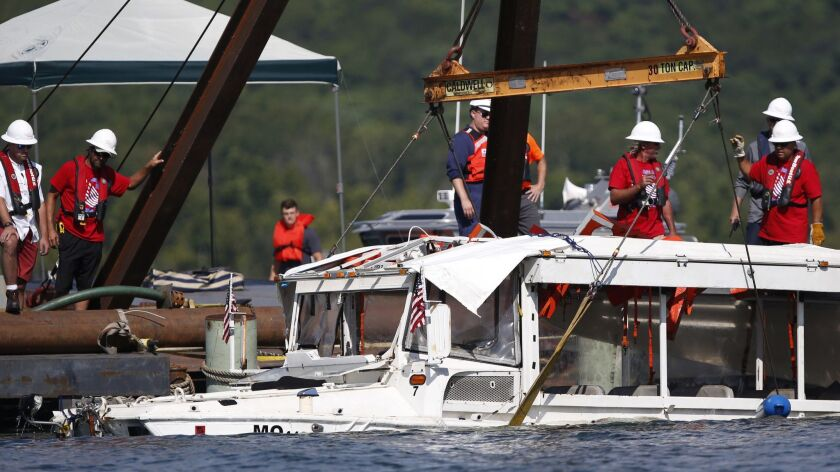 The duck boat that sank in Table Rock Lake in Branson, Mo., is raised Monday, July 23, 2018. The boa