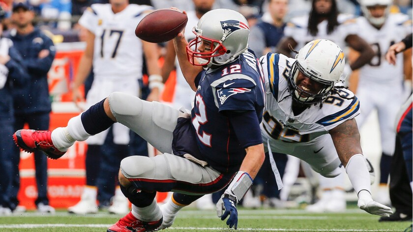 Darius Philon gets Tom Brady here, but Brady and the Patriots beat the Chargers 21-13 when they last met on Oct. 29, 2017.