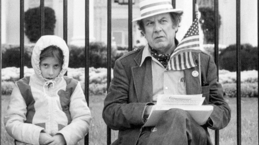 "Jenny and Alan Abel in front of the White House, in a photo from the Slamdance documentary ""Abel Raises Cain."" Alan Abel died Sept. 14 at age 94."