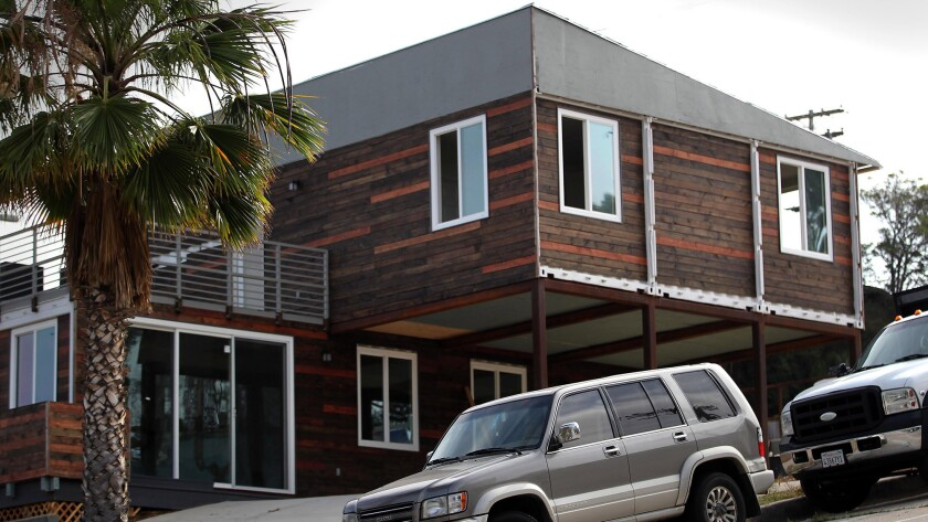 The container house is set on a steep part of Island Avenue, at the corner of 26th Street.