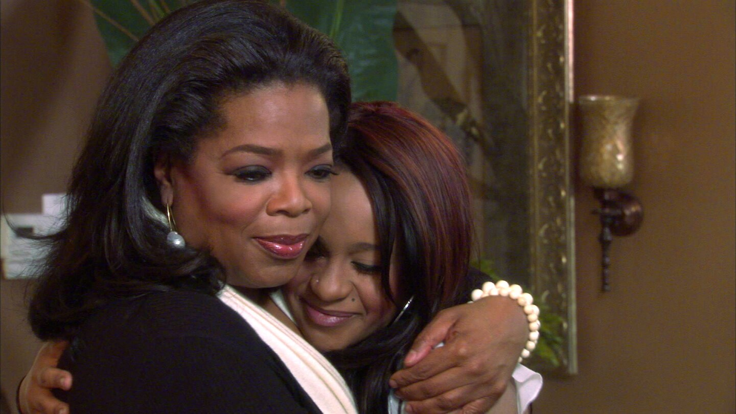 Oprah Winfrey, left, embraces Bobbi Kristina Brown, daughter of the late singer Whitney Houston, during an interview in Atlanta in March 2012.