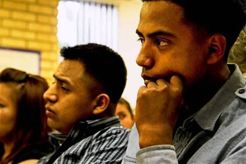 """Abelardo Popec, left, and Romaldo Lopez listen to speakers as indigenous Mexican students and leaders of Ventura County public schools launched the """"No Me Llames Oaxaquita"""" (Don't call me little Oaxacan) campaign at the Center for Employment Training in Oxnard."""