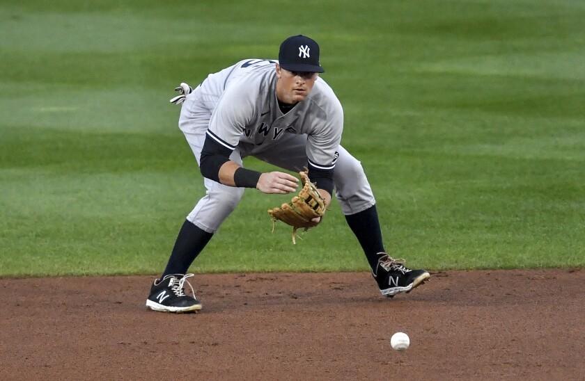 New York Yankees' DJ LeMahieu fields a grounder by Toronto Blue Jays' Teoscar Hernández on Sept. 22 in Buffalo.
