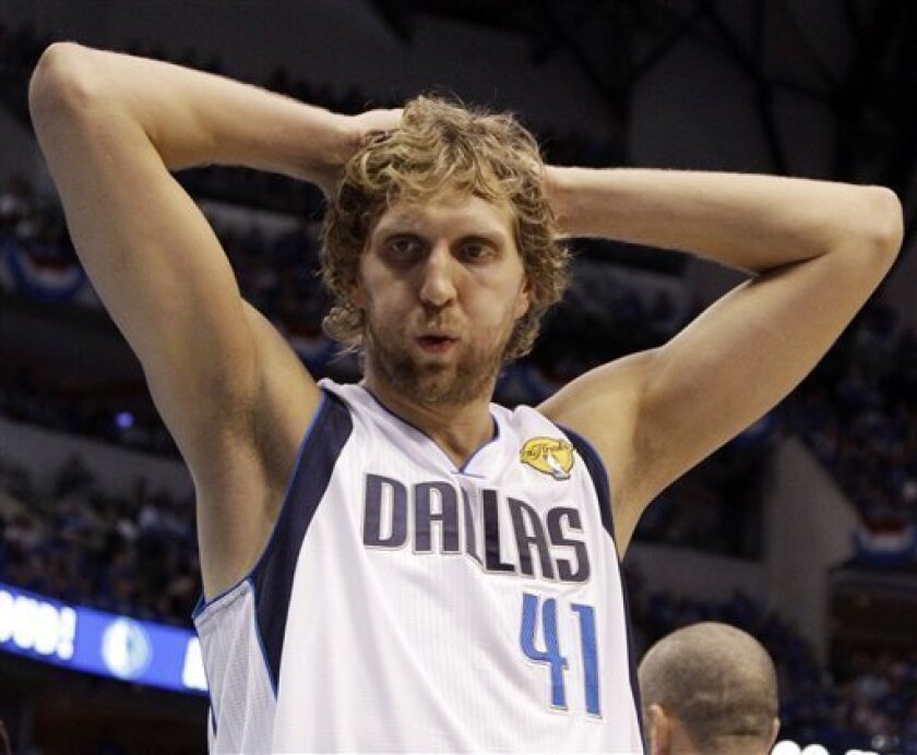 Dallas Mavericks' Dirk Nowitzki reacts during the first half of Game 4 of the NBA Finals basketball game against the Miami Heat Tuesday, June 7, 2011, in Dallas. (AP Photo/David J. Phillip)
