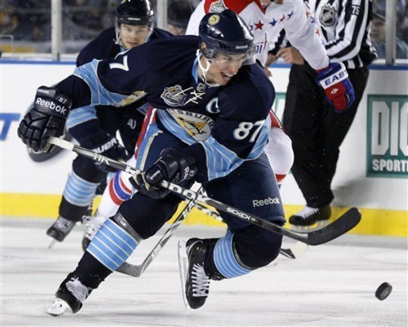 Pittsburgh Penguins' Sidney Crosby (87) skates against the Washington Capitals in the first period of the NHL Winter Classic outdoor hockey game in Pittsburgh, Saturday, Jan. 1, 2011. The Capitals won 3-1. (AP Photo/Gene J. Puskar)