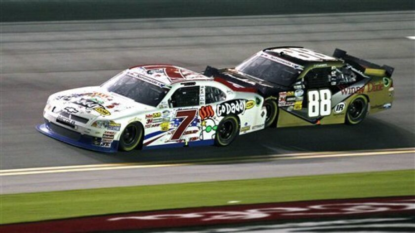 Danica Patrick (7) runs in first place in front of Cole Whitt (88) during the Nationwide Series NASCAR auto race at Daytona International Speedway, Friday, July 6, 2012, in Daytona Beach, Fla. (AP Photo/Terry Renna)