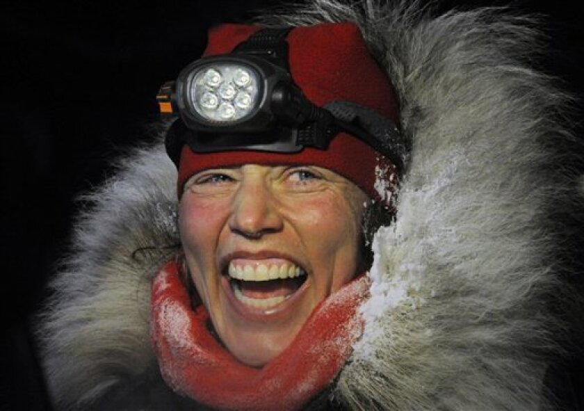 Aliy Zirkle finished second in the Iditarod for the second consecutive year when her dog team crossed under the burled arch in Nome on Tuesday evening, March 12, 2013. (AP Photo/The Anchorage Daily News, Bill Roth)  LOCAL TV OUT (KTUU-TV, KTVA-TV) LOCAL PRINT OUT (THE ANCHORAGE PRESS, THE ALASKA DI