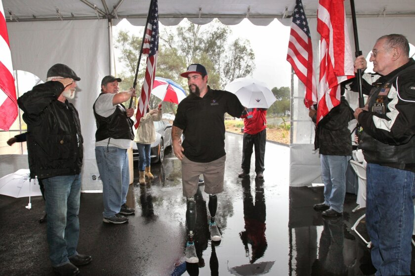 Triple amputee and foprmer USMC Sgt. Nick Kimmel arrives at his new house given to him by the Gary Sinese Foundation.