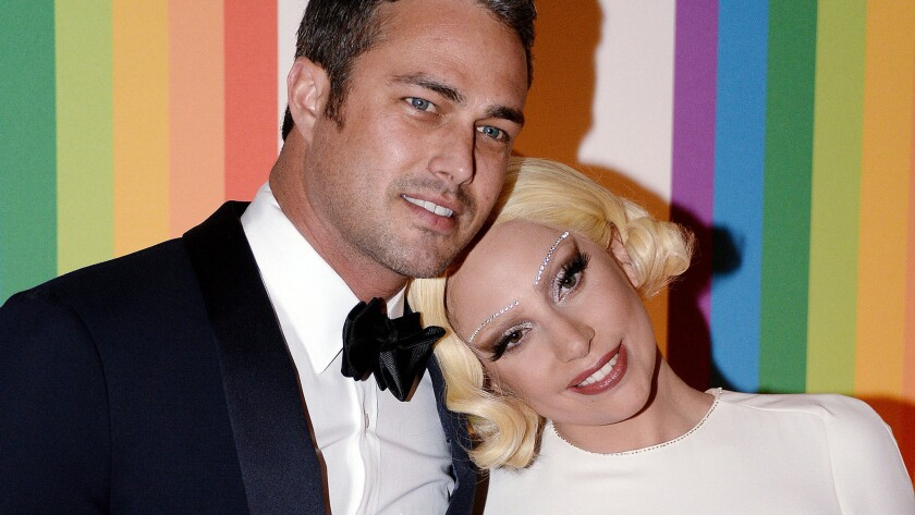 Taylor Kinney and Lady Gaga, shown together at the 2014 Kennedy Honors in December, got engaged on Valentine's Day.