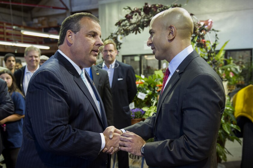 New Jersey Gov. Chris Christie, left, greets California Republican gubernatorial candidate Neel Kashkari during an event held at the Hoogasian Flowers Inc. shop in San Francisco on Friday.