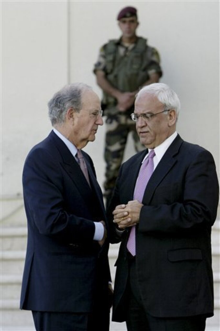 Special Envoy for Middle East Peace George Mitchell, left, and Chief Palestinian negotiator Saeb Erekat, right,are seen after a meeting with Palestinian President Mahmoud Abbas, in the West Bank city of Ramallah in the West Bank city of Ramallah, Thursday, Sept. 30, 2010. A U.S. emissary racing against the clock to salvage Mideast peace negotiations scheduled another quick round of meetings with Israeli and Palestinian leaders after talks Thursday with Palestinian President Mahmoud Abbas ended inconclusively. (AP Photo/Majdi Mohammed)