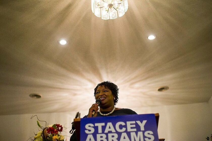 """Georgia gubernatorial candidate Stacey Abrams speaks at Mount Pisgah Primitive Baptist Church during a """"Get Out The Vote"""" rally in Metter, Ga., on Monday."""