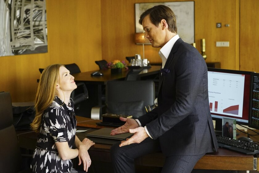"""This image released by ABC shows Mireille Enos, left, and Peter Krause in a scene from """"The Catch,"""" airing Thursday at 10 p.m. ET on ABC. (Richard Cartwright/ABC via AP)"""