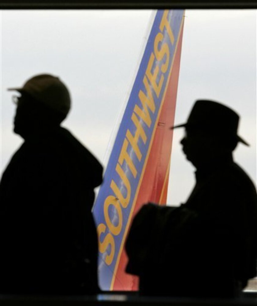Southwest Airlines passengers lined up for a flight to St. Louis. The carrier has a new pay-for-priority boarding option. (2006 file/AP)